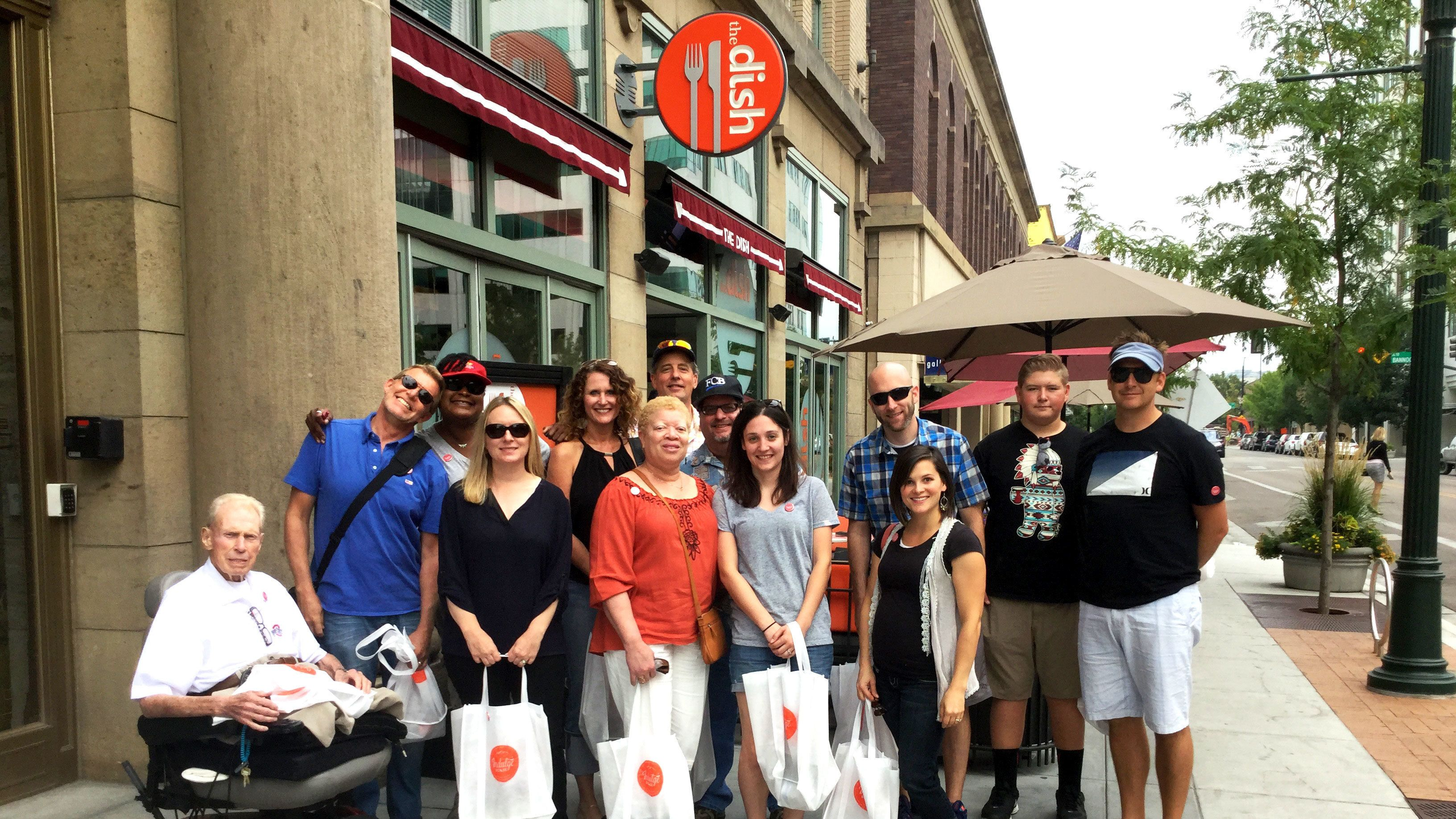 Group stands in front of restaurant on food tour in Boise