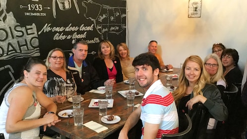 Group smiling for picture during brunch in Boise