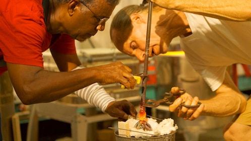 Two people blowing glass in Aruba