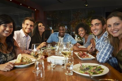 Group poses for photo during dinner at a Las Vegas casino