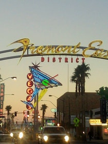 Illuminated signs of Fremont street with traffic at dusk