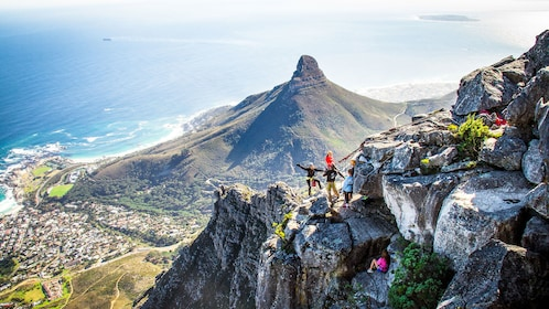 Group stops from abseiling to take in view on Table Mountain in Cape Town