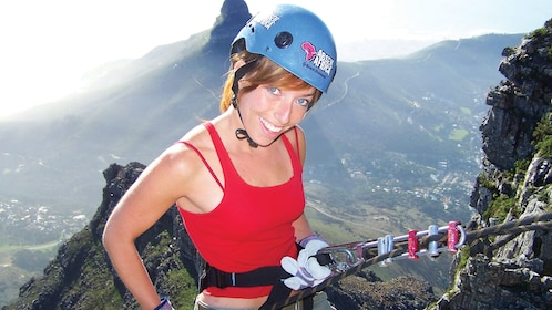 Woman preparing to abseil down Table Mountain in Cape Town