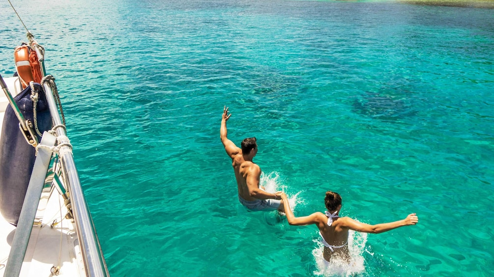 Show item 2 of 5. Guests swimming on the Full Day Reef Safari in Seychelles