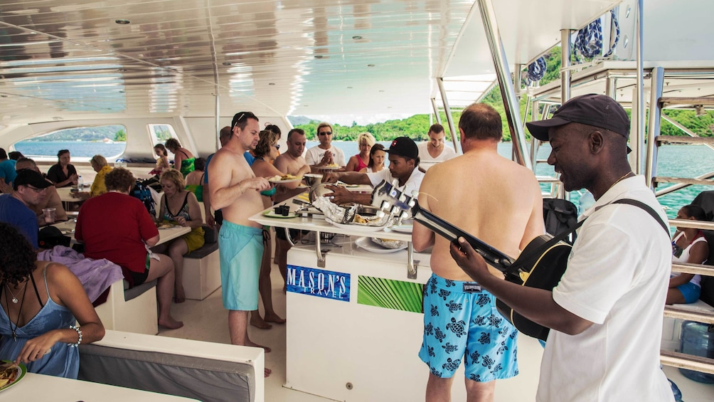 Show item 3 of 5. Entertainment aboard the boat for the Full Day Reef Safari in Seychelles