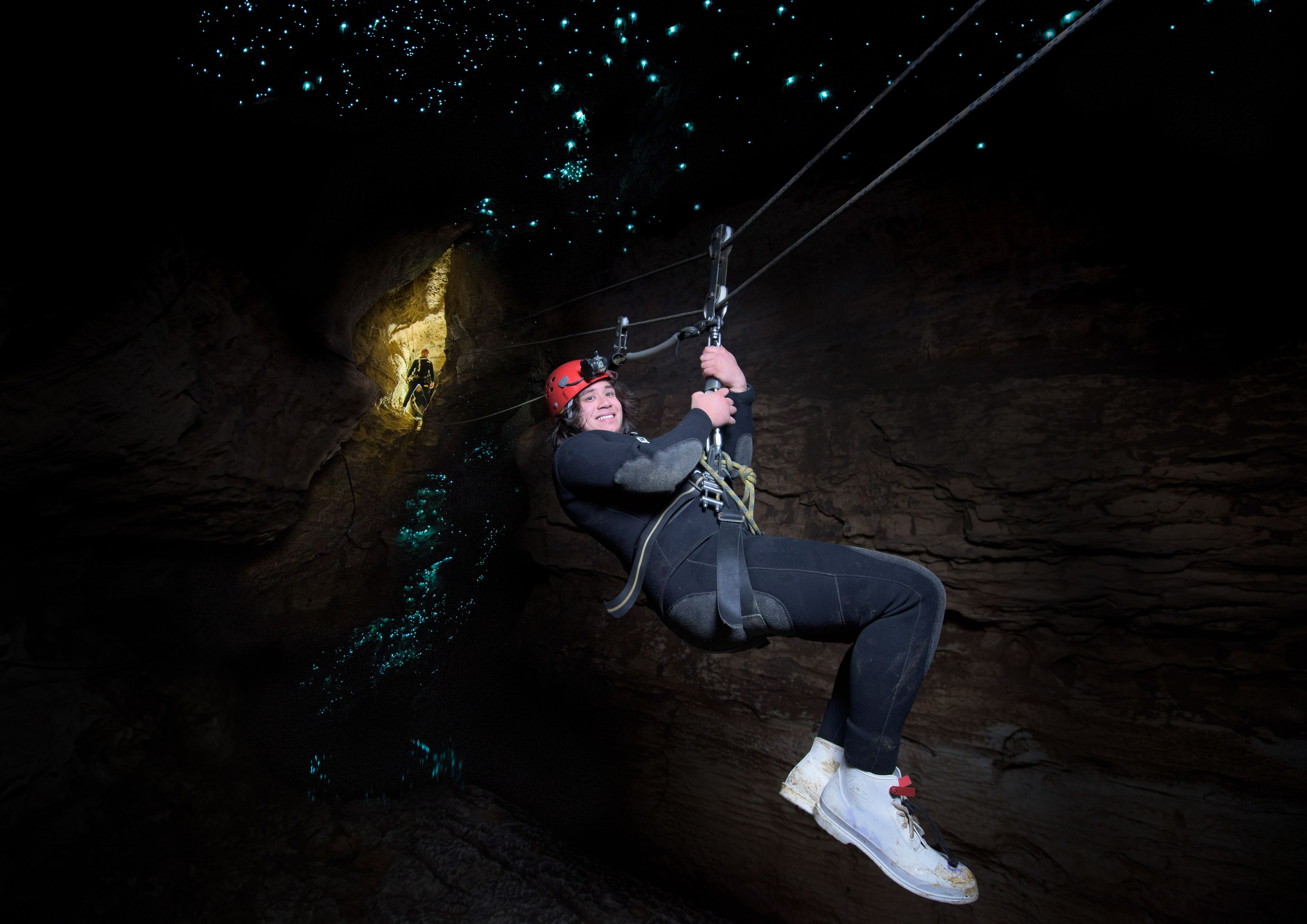 Person ziplining through cave in Auckland