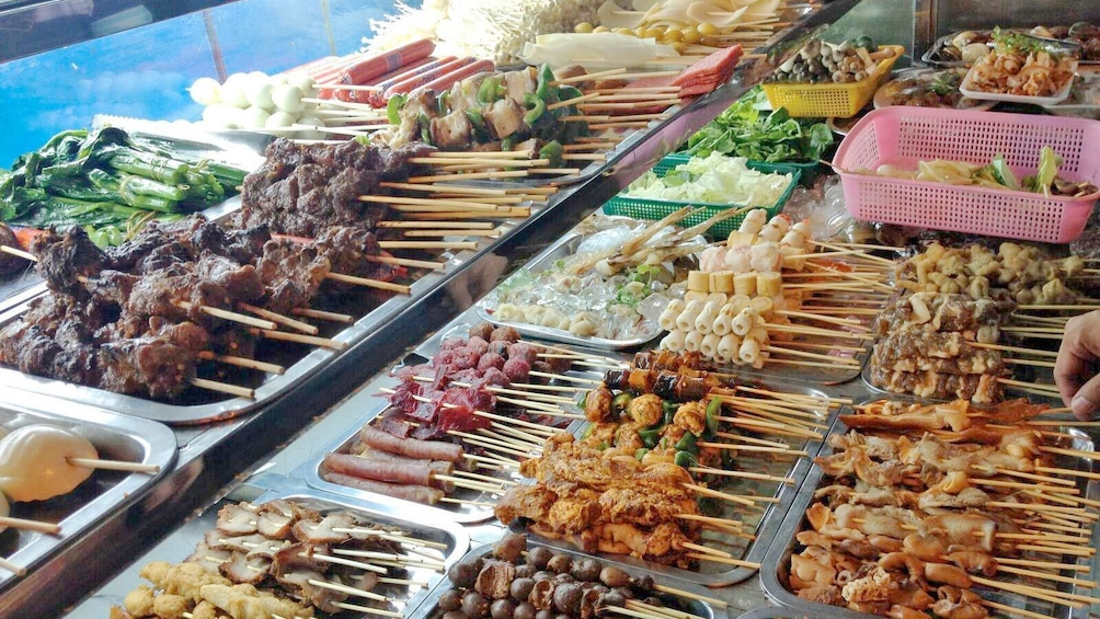 Show item 1 of 5. Food skewers seen on the  Burmese Market Tour