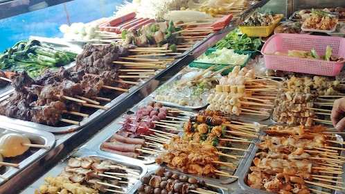 Food skewers seen on the  Burmese Market Tour