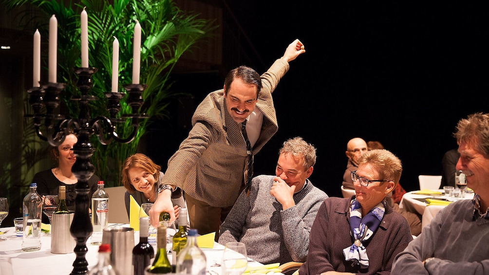 Show item 3 of 5. Actor interacting with audience during Faulty Towers show in London