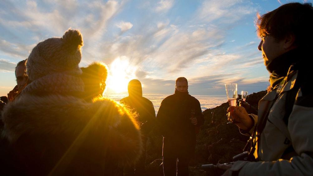 Indlæs billede 5 af 4. People enjoying drinks on Teide volcano in Spain