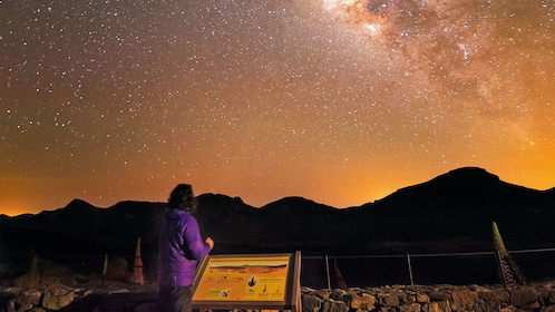 Woman looking up at the stars over Teide volcano