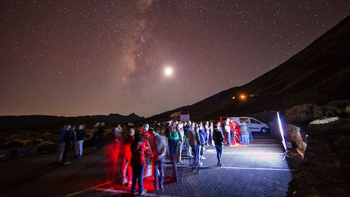 Group stargazing at base of Teide volcano