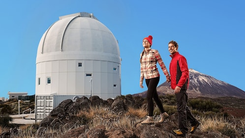 Couple walking around Teide Observatory