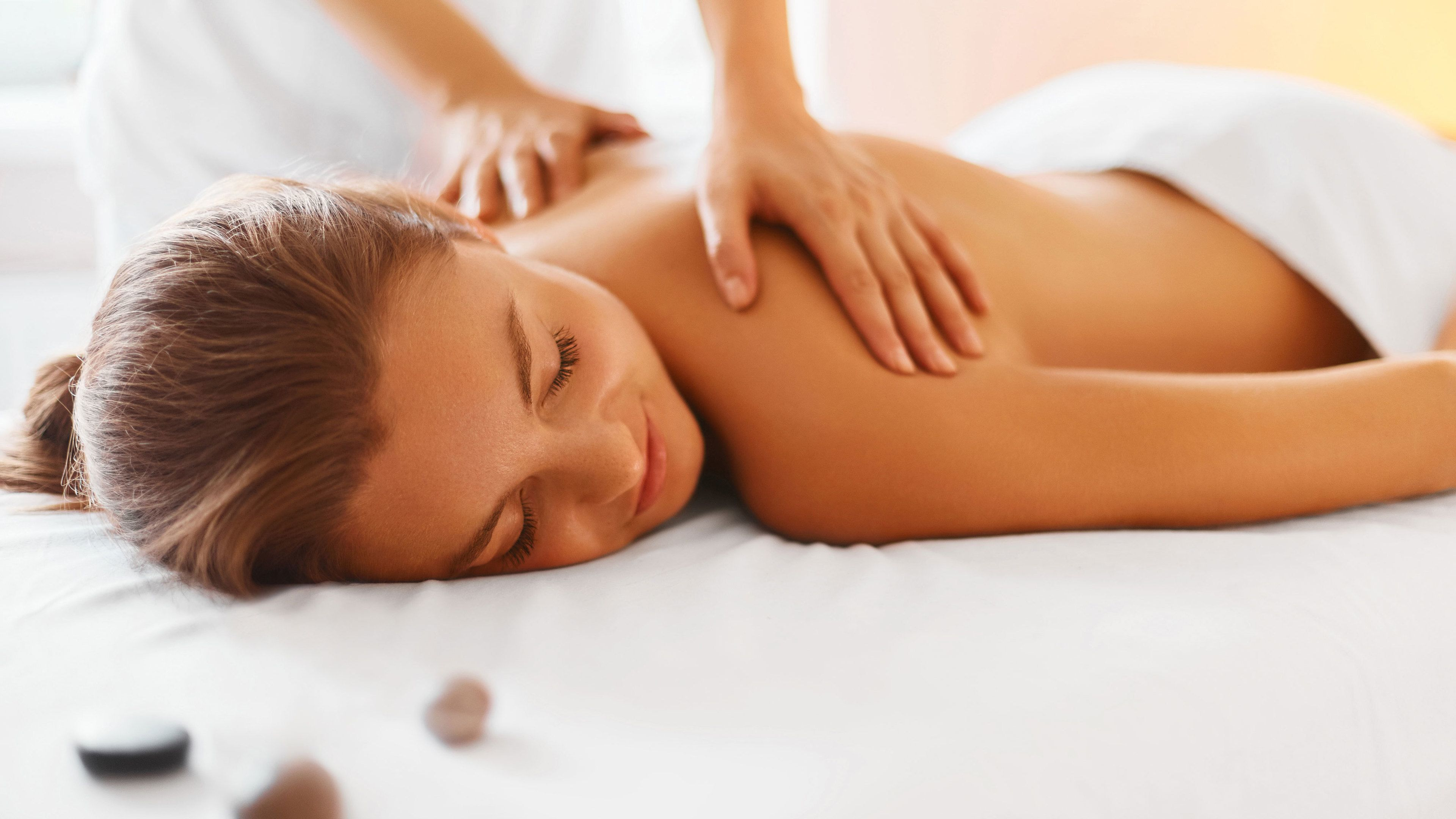 Woman getting a massage at a spa in Hoi An