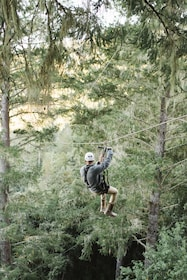 Man looking at view as he ziplines across in Sonoma County