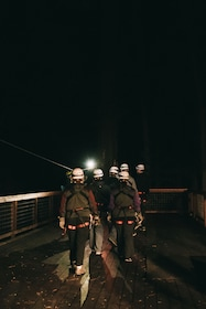 Group preparing to go ziplining at night in the Redwoods of Sonoma County