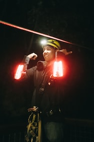 Woman ziplining at night in the Redwoods of Sonoma County