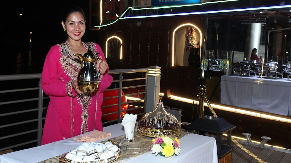Show item 2 of 7. Staff ready to serve guests during dinner cruise in Dubai