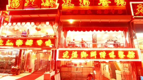 Restaurant lit up by neon signs in Shenzhen