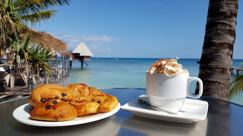 Pastries and coffee at a seaside cafe in New Caledonia