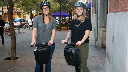 Two women on segways tour around Fort Worth