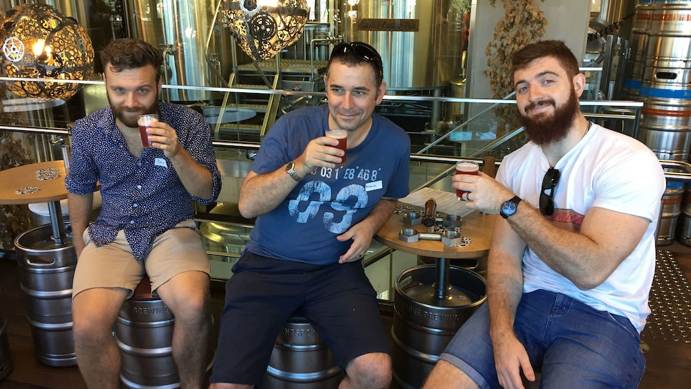 Trio trying beer samples at brewery in Canberra