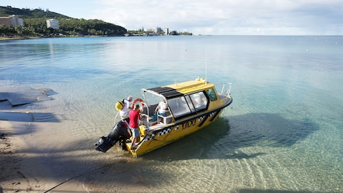 Passengers getting on a boat for the Aquarium and Duck Island Tour in New Caledonia