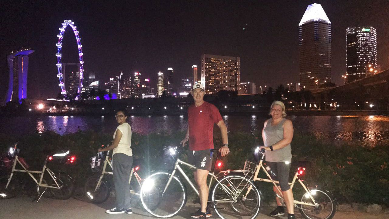 Group on bikes along Marina Bay in Singapore