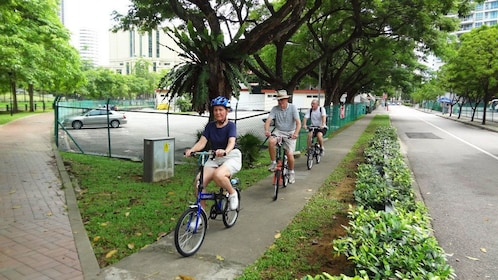Bicycle group riding down street in Singapore