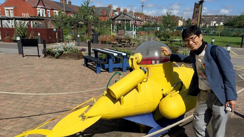 Man with a yellow submarine in Liverpool
