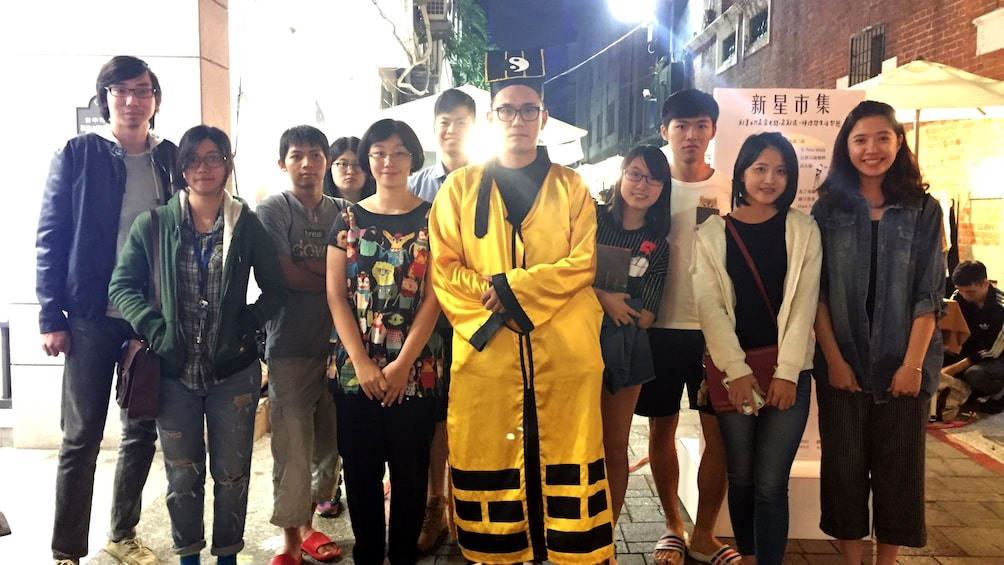 Show item 5 of 5. Group standing for picture while touring downtown Taichung
