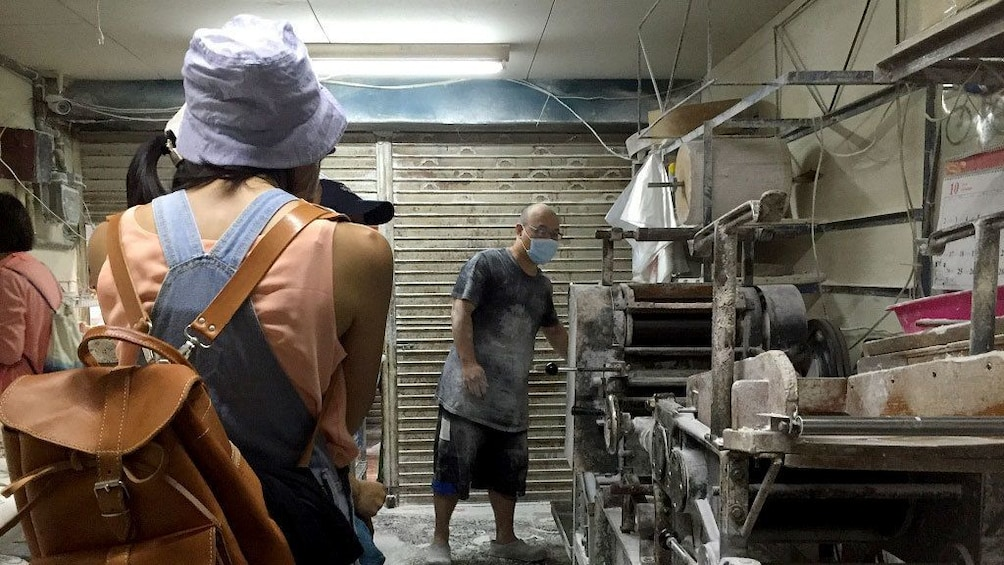 Show item 3 of 5. Tour group in a kitchen in Taichung
