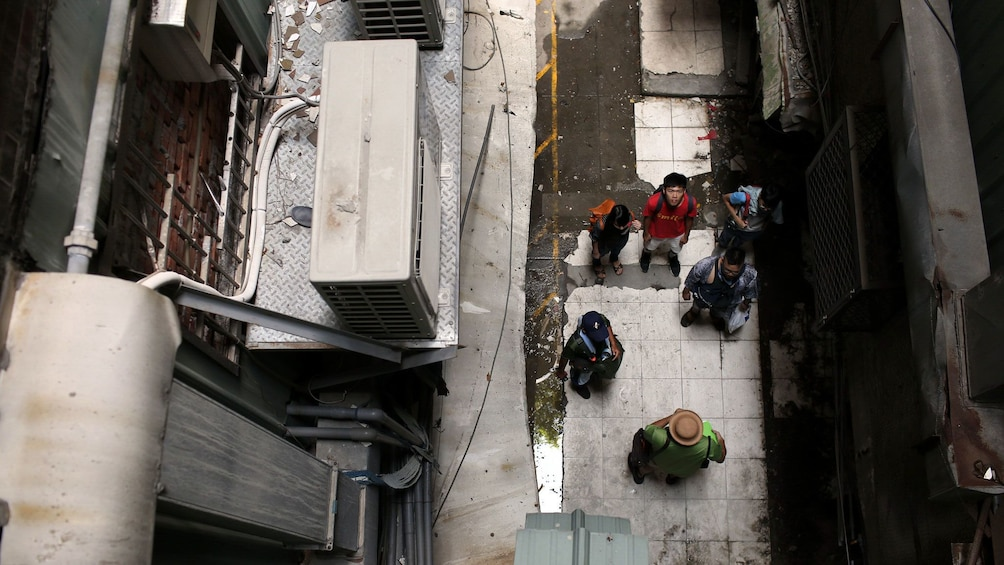 Show item 2 of 5. Tour group in an alley in Taichung