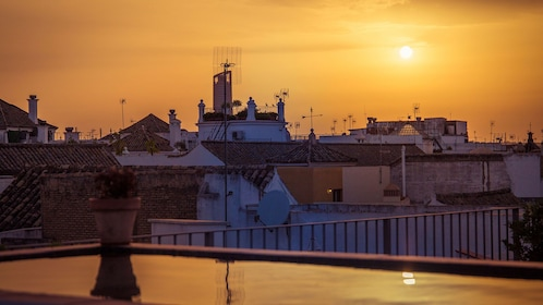 View of rooftops in Seville at sunset