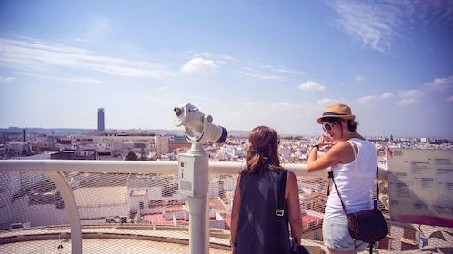Two woman looking out over Seville rooftops