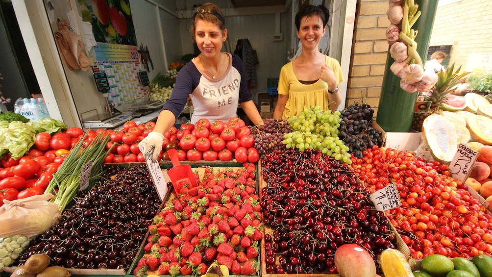 Show item 1 of 10. Vendors at a fruit market in Warsaw