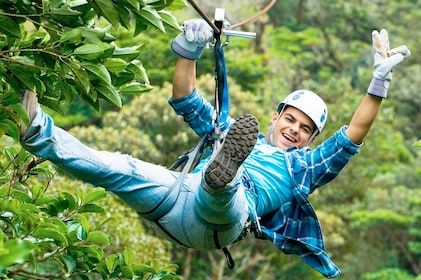 Person on a zip line in a jungle
