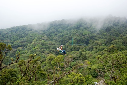 Person zip lining above Costa Rican jungle