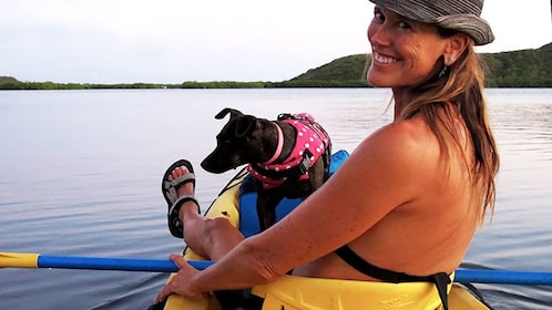 Woman in kayak with pet dog in Mangrove Lagoon