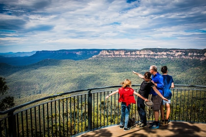 Family at a lookout point with a view of the mountains in Australia