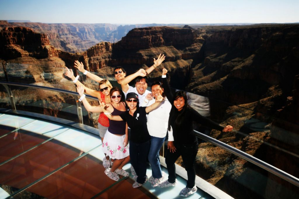 Tourists stand on the West rim of the Grand Canyon