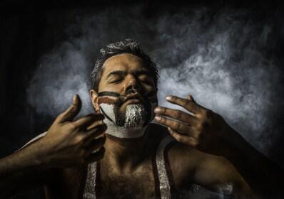 Man paints his face as a Aboriginal in Blue Mountains, Australia