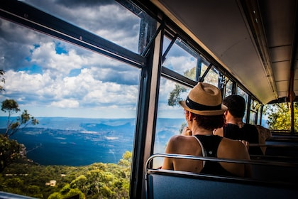People look out window of a Gondola cart in the Blue Mountains of Australia
