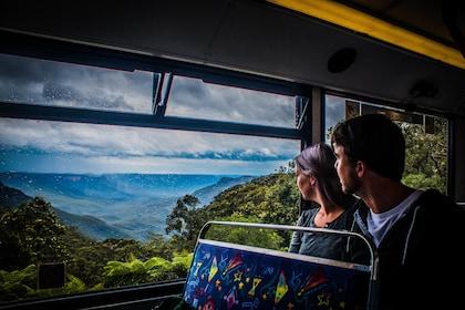 Two people sit inside train in Blue Mountains, Australia