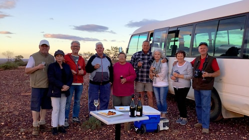 Desert Cave Town tour group in South Australia at dusk