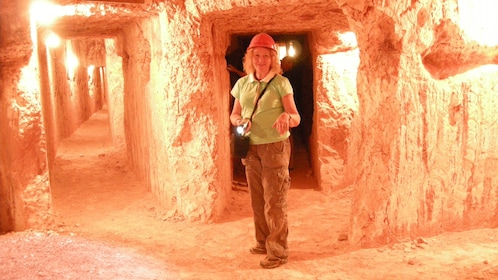 Woman smiling inside a cave in Adelaide