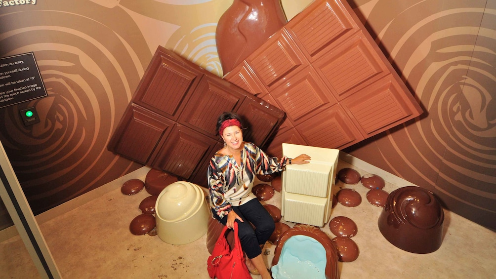 Show item 1 of 4. Woman smiling at the Amazing World of Chocolate in Australia