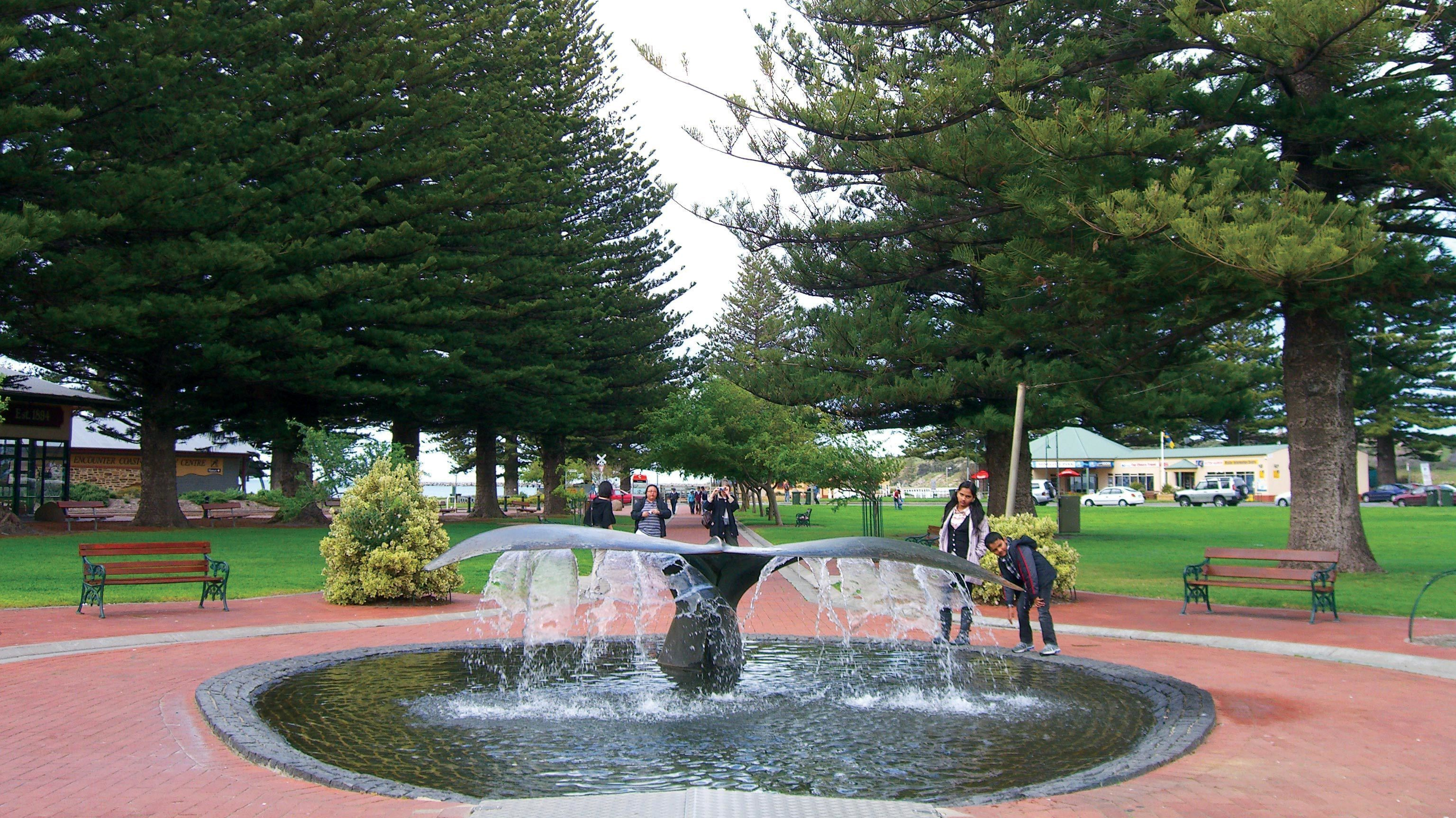 A whale tail fountain at a park in Victor Harbor