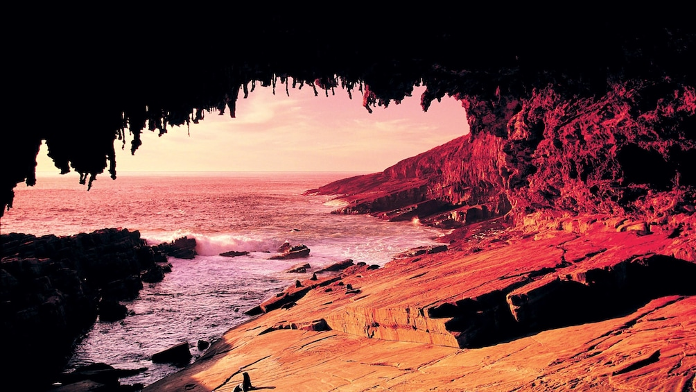 Show item 1 of 6. View of the coast of Kangaroo island from a cave at sunset