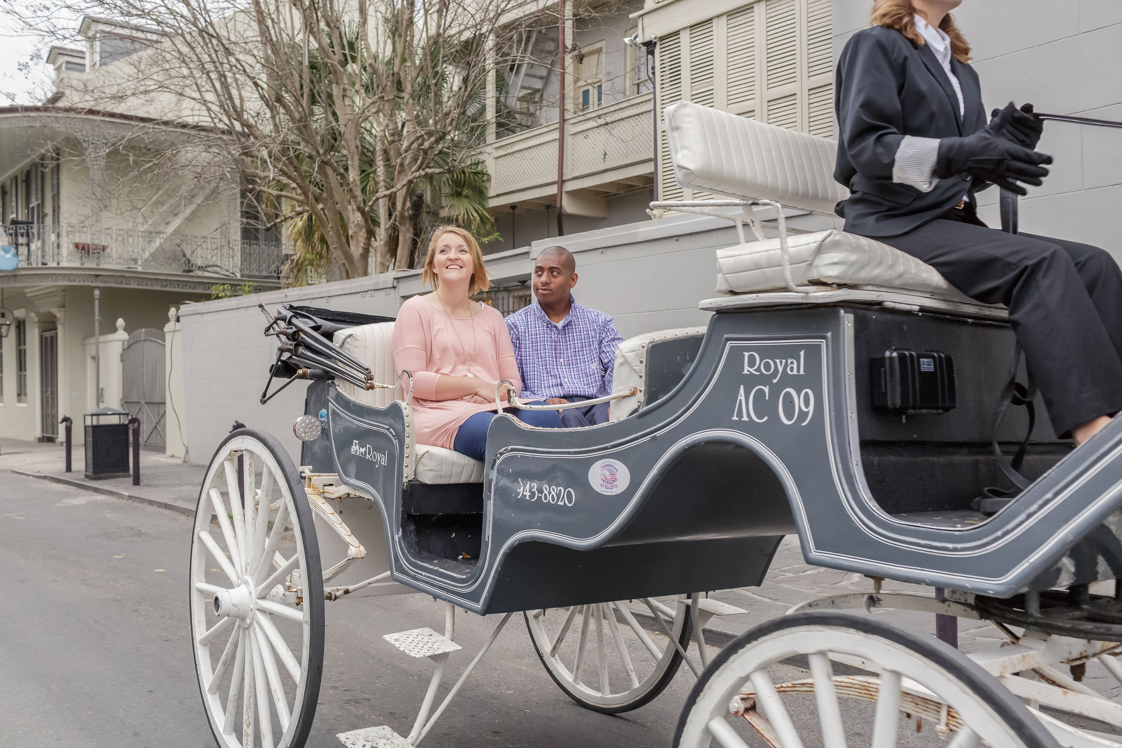 Couple in a horse-drawn carriage in New Orleans